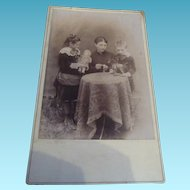 Wonderful antique photo card with early portrait type doll