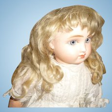 Antique small size blond mohair doll wig with bangs
