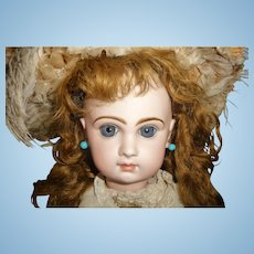 Gorgeous antique Bebe Jumeau french doll size with antique extended mohair wig