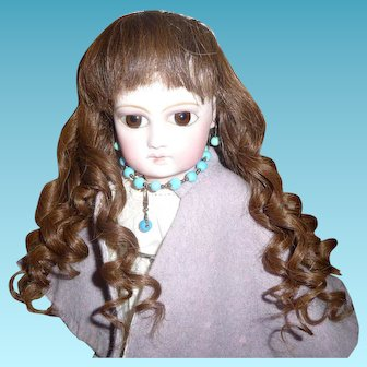 Beautiful antique brunette human hair wig with bangs