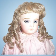 Beautiful antique hand tied blond mohair doll wig with curls and bangs