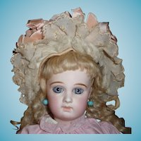 Beautiful antique wool doll bonnet with pink ribbons