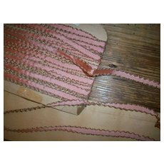 Pink and gold edged silk and metal doll dressing trim/ribbon