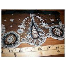 Hand beaded black silk lace trim piece