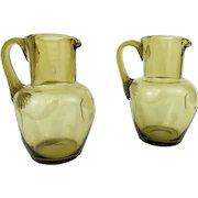 2 Antique 19th century Bohemian Wine Pitchers Green Glass Harrach Jugs Decanters