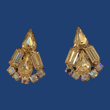 Signed Weiss yellow prong set rhinestone's with Aurora Borealis rhinestones clip on earrings