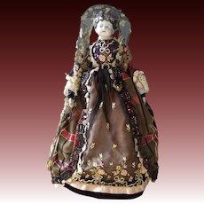 Antique China head doll in period costume