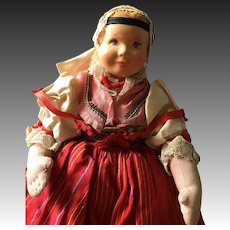 Vintage folk doll with removable costume