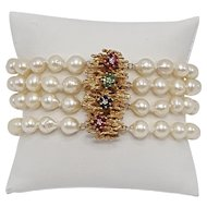 Four-strand Pearl Bracelet with 14k Gold, Emerald, Sapphire, and Ruby Clasp