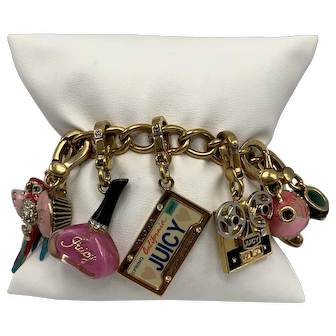 Juicy Couture Bracelet with Eleven Charms Including Chandelier, Parrot, Ice Cream and More