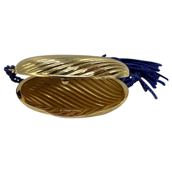 1980s Signed Judith Lieber Gold Gilt Ribbed Oval Pillbox or Locket With Blue Fabric Tassel