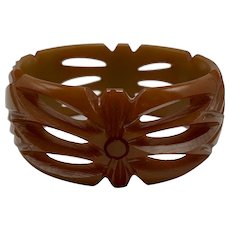 Pierced and Carved Butterscotch Bakelite Bangle with Geometric Floral Design