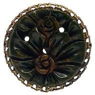 1940s Heavily Carved Round Bakelite Floral Dress Clip with Gold-tone Metal Bezel