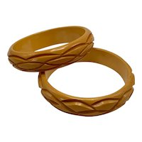 Matching Pair Vintage Carved Butterscotch Bakelite Bangles