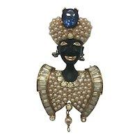 Vintage Blackamoor Brooch with Large Stone, Faux Pearls, and Baguette Rhinestones