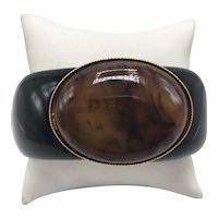 Black Clamper Bracelet with Large Oval Stone Set in Gold-tone