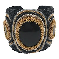 Cuff Bracelet with Gold Color and Pearlized Beads and Three Large Oval Stones