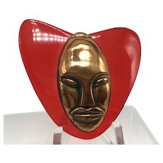 Elzac Victim of Fashion Copper Face on Red Lucite Brooch