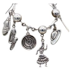 Outstanding Vintage Taxco Mexican sterling silver bull fight 9 charm bracelet by FARFAN 52+g