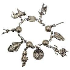Vintage Taxco Mexican sterling silver 9 charm bracelet bullfight FARFAN