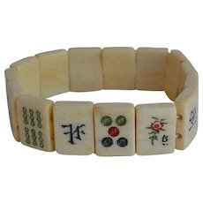 Antique Chinese or Japanese hand carved bovine bone stretch bracelet with symbols and letters