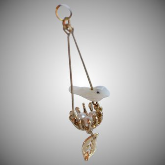 Vintage Mother of Pearl Bird with Nest and faux pearls Eggs gold metal Pendant