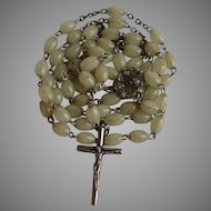 Vintage 5 decades glowing in the dark Catholic rosary with light grey glowing in the dark plastic olive shape beads