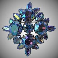 Vintage signed Sherman blue aurora borealis rhinestone & silver tone metal layered flower or Maltese Cross high domed brooch pin