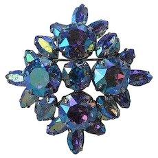 Vintage signed Sherman blue aurora borealis rhinestone & silver tone metal layered flower or Maltese Cross high domed brooch pin