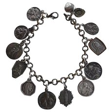 Victorian Charm Bracelet with 12 antique Religious Medals some silver and some signed