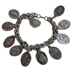 Old charm Bracelet with 11 antique religious medals