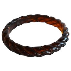 Vintage molded swirl faux amber translucent plastic domed Bangle Bracelet with twisted rope shape