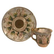 Vintage Capodimonte cup & saucer set decorated with cherubs angels.