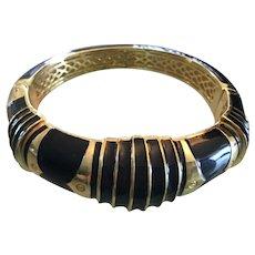 Cristina Sabatini cuff bracelet gold plated decorated with black enamel marked.