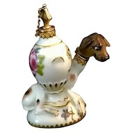Antique 18th century French porcelain gold mounted perfume bottle with dog.