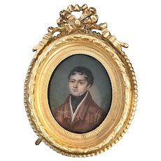 18th Century Hand painted miniature portrait of young man, gold frame.