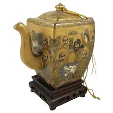 Antique Japanese Satsuma Covered Teapot With Hand Painted Immortals on a Wood Stand, circa 1880