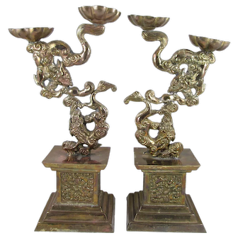 Pair of Chinese Brass Candle Holders / Oil Lamps with Mythical Figures on Pedestals