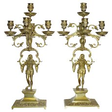 Pair of Renaissance Revival Figurative Bronze Candelabra