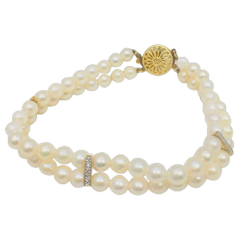 Double strand Akoya pearl and diamond bracelet with yellow gold fancy floral pearl clasp