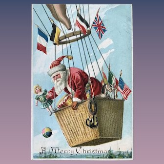 Santa In Hot Air Balloon Embossed Postcard Dropping Toys Dolls American British and European Flags