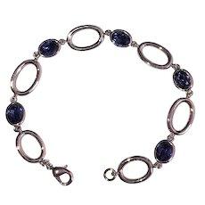 Oval Silvertone Linked Bracelet with Pretty Sparkling Purple Glass