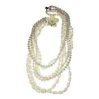 Multi Strand White and Clear Beaded Necklace with Enameled Flower Clasp