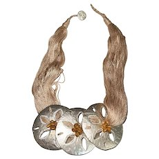 Multi Strand Beige Necklace with Three Large Silvertone Sand Dollars