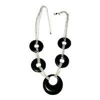 Multi Strand Silvertone Chain Necklace with Black Disk Accents