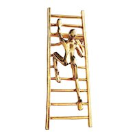 Man Climbing a Ladder Goldtone Brooch