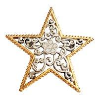 Silvertone Filigree Star Framed in Goldtone Brooch with Rhinestone Flower