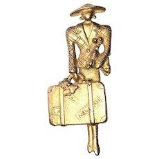 AJC signed Elegant Traveling Woman Goldtone Brooch
