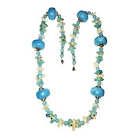 Beautiful Sky Blue Beaded Necklace with Polished Shells and Goldtone Accents