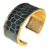 ST. JOHN signed Wide Goldtone Cuff Bracelet with Black Leather Center
